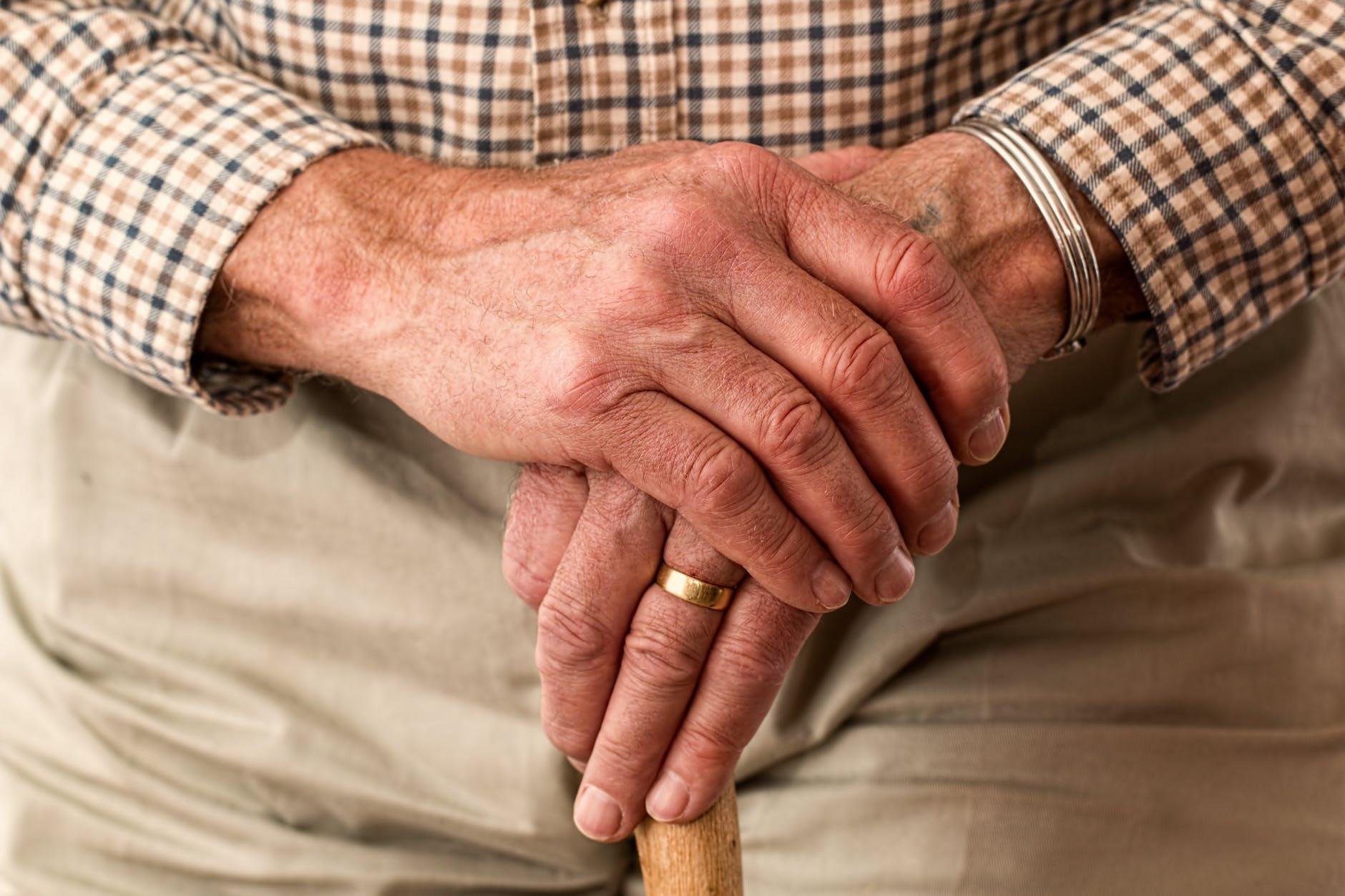 man hands waiting senior